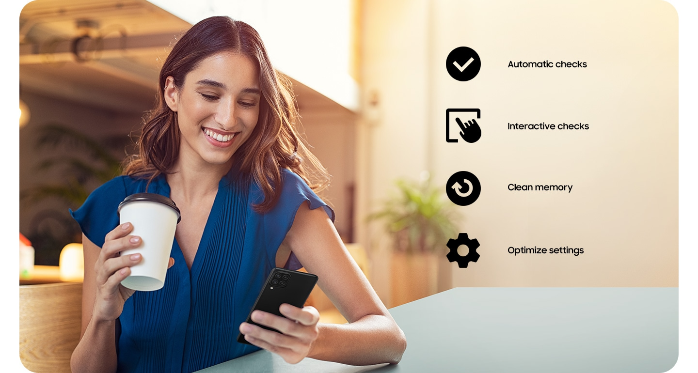 A woman holding a coffee cup and using her Galaxy A22. A checkmark icon for Automatic Checks, an icon of a hand tapping a screen for Interactive checks, an icon of arrow going in a circle for Clean memory and a cog icon for Optimize settings.