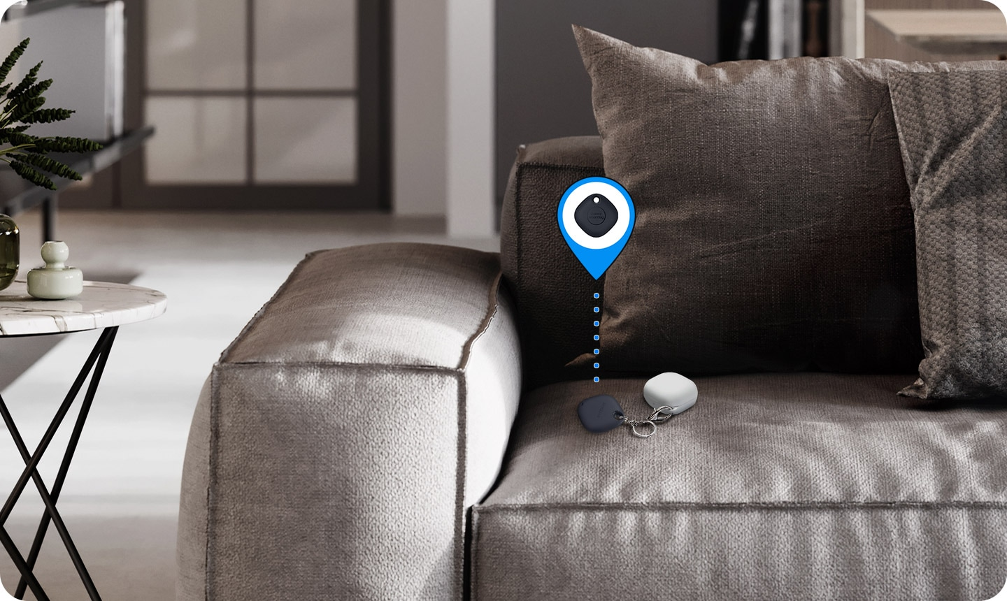 On a sofa, Galaxy Buds in the corner is seen with SmartTag attached. Virtual icon indicates that tag helps users find items