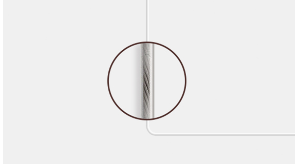 Closeup of One Invisible Connection cable shows its transparent material which greatly reduces its visibility.