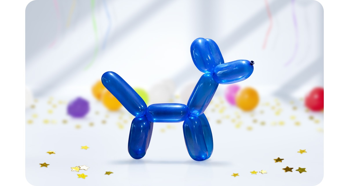 1. A blue dog-shaped balloon stands at the forefront, with other balloons and decorations in the background. Only the dog is in focus.