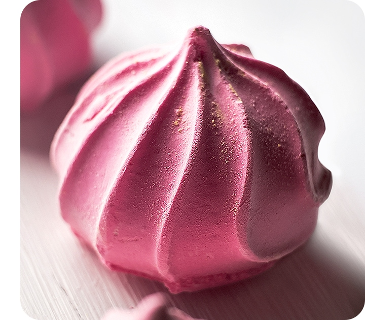 A detailed close-up of a pink meringue taken with the Macro Camera shows its texture clearly.