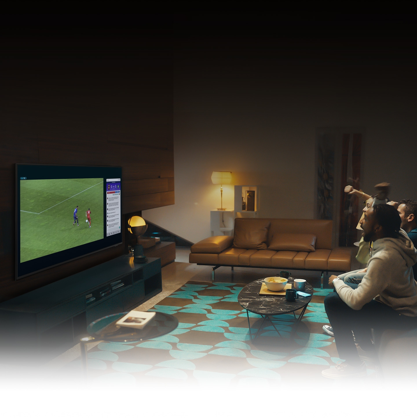 A group of people use UHD TV Multi view feature to enjoy a football match and view play-by-play information at the same time on the same screen.