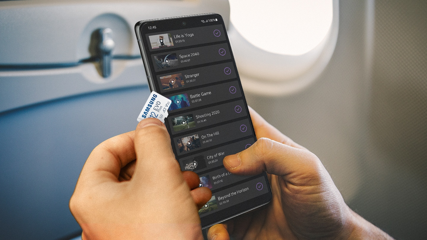 microSD card on a smartphone, which is showing several lists of large capacity video files. Expand the capacity of your device with microSD card and enjoy a variety of contents.