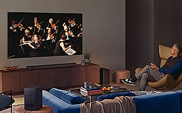 A man is watching a concert.