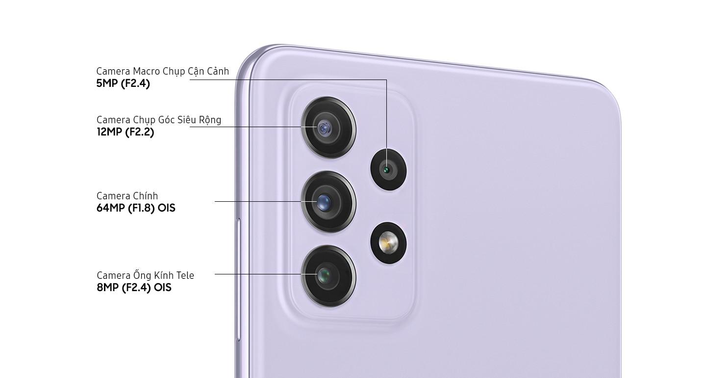 Cận cảnh Bộ bốn camera (Quad Camera) tiên tiến trên kiểu máy màu Tím Thanh Lịch, cho thấy Camera Ống Kính Tele F2.4 8MP OIS, camera chính F1.8 64MP OIS, Camera Chụp Góc Siêu Rộng F2.2 12MP và Camera Macro F2.4 5MP.