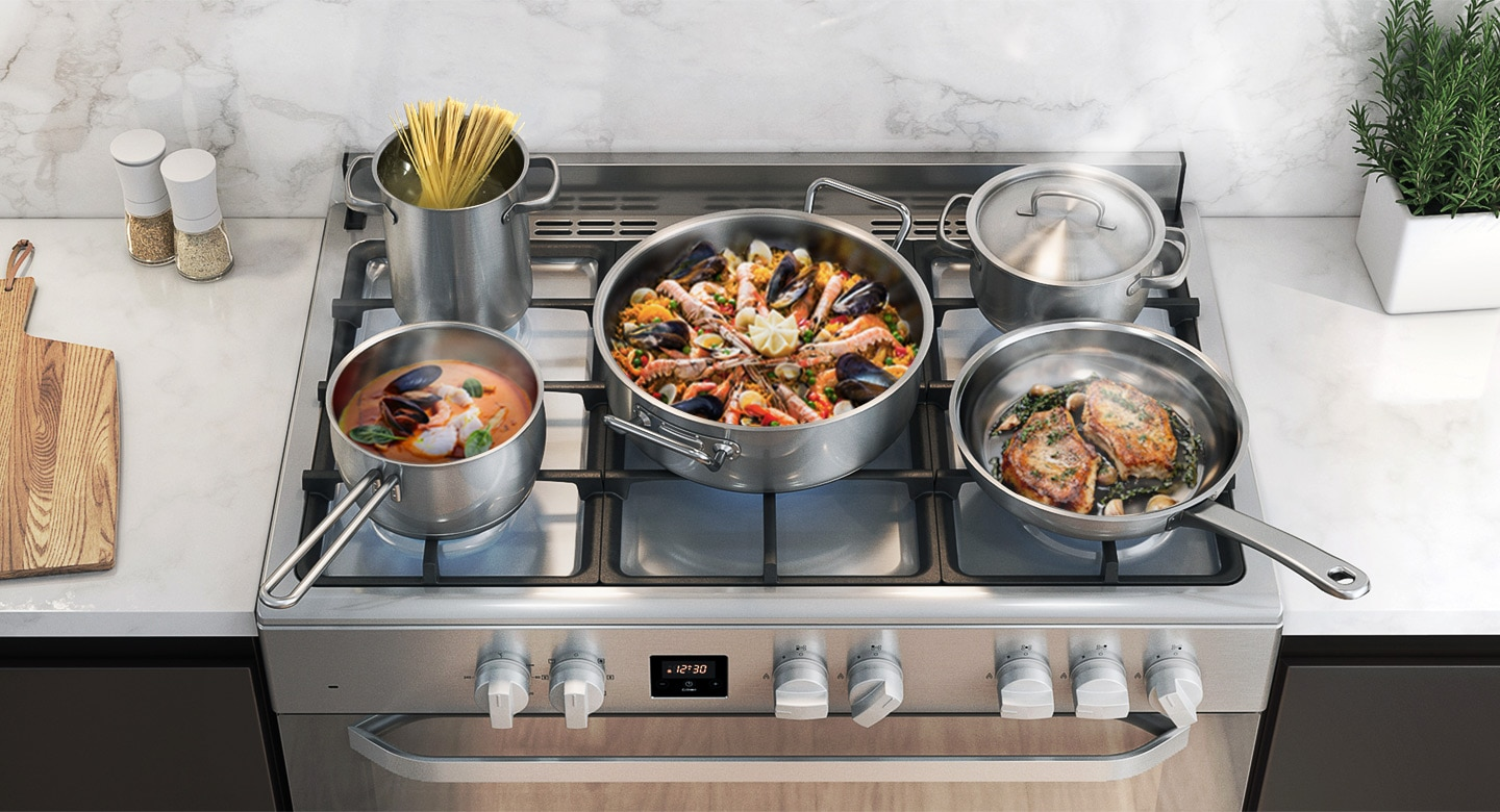 Various types of food (pasta noodles, paella, steak, etc.) are being cooked on the cooktop.