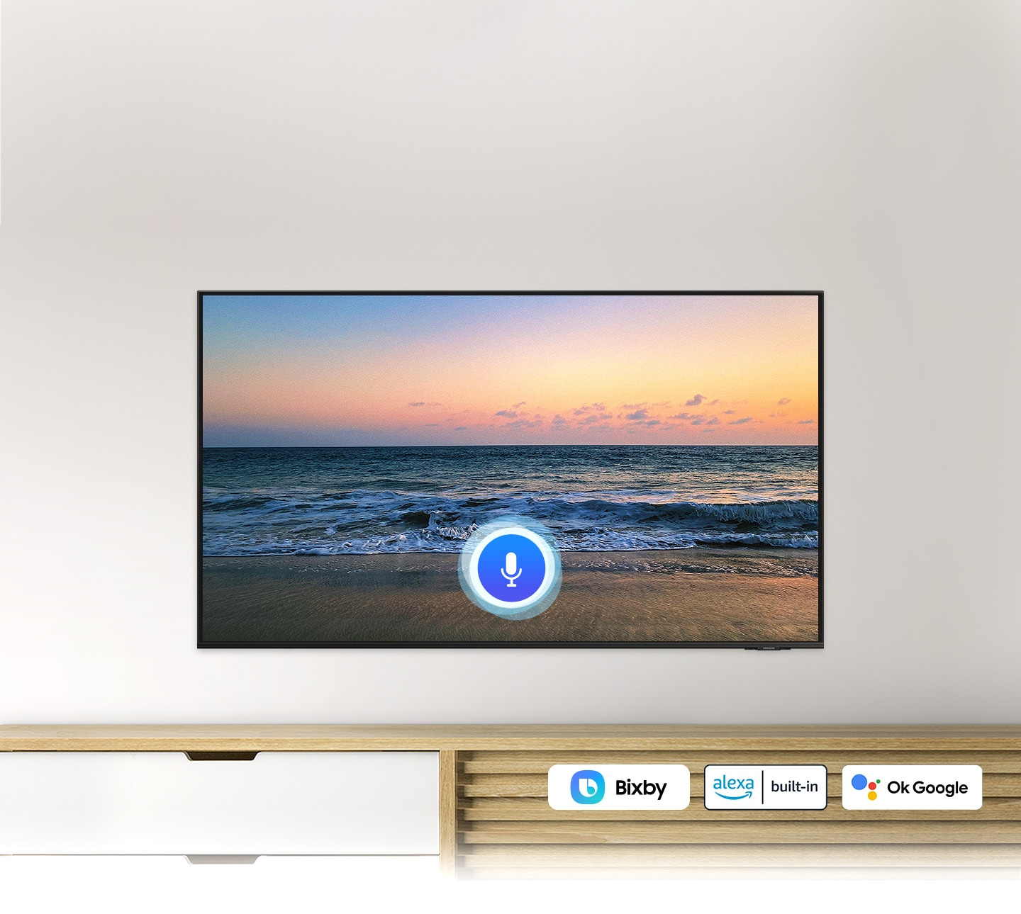 A microphone icon overlays a beach sunset TV screen image, demonstrating UHD TV voice assistant feature.