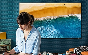 a woman facing front, TV back