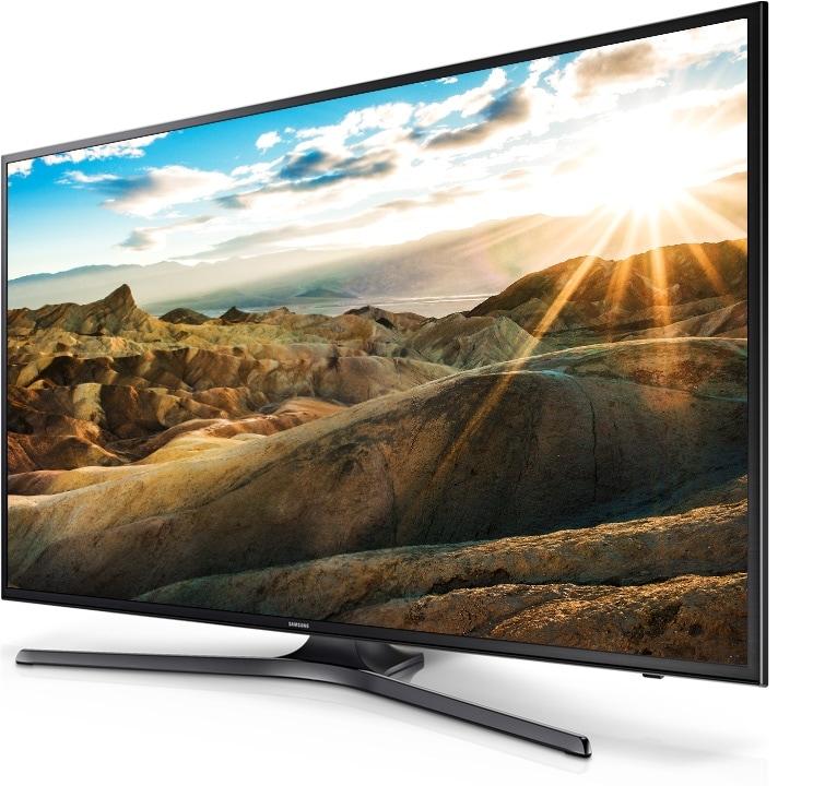 perspetiva direita de uma TV Samsung UHD com uma paisagem brilhante no ecrã