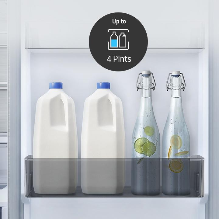 Depozitează sticle mai multe și mai mari în ușa frigiderului