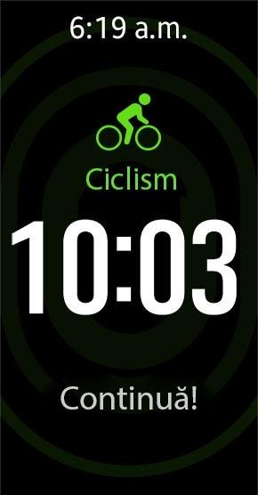 Dispozitivul Gear Fit2 monitorizează sesiunea de ciclism în modul de urmărire automată, arătând pe ecran timpul și un mesaj motivant