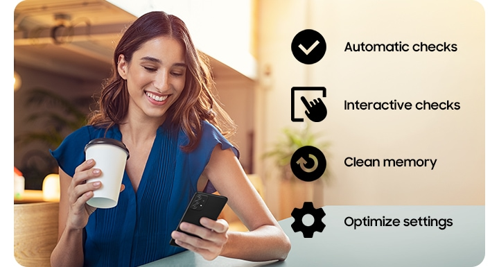 A woman holding a coffee cup and using her Galaxy A52 5G. A checkmark icon for Automatic Checks, an icon of a hand tapping a screen for Interactive checks, an icon of arrow going in a circle for Clean memory and a cog icon for Optimise settings.