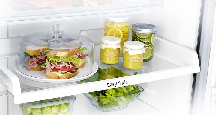 Samsung Twin Cooling Plus Top Freezer Fridge – an image of Easy Slide shelf for easy access to items at the back