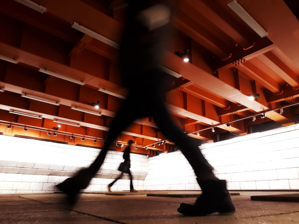 Pedestrians commuting to and from work through a downtown underground walkway.