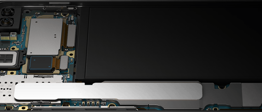 Galaxy S10 plus in landscape mode, propped up at a slight angle from the Bixby and volume button side with the interior hardware revealed, showing the pieces that make Galaxy S10 plus optimized for gaming.