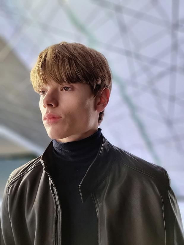 Man wearing a leather jacket, taken in Portrait Mode with Studio effect applied.