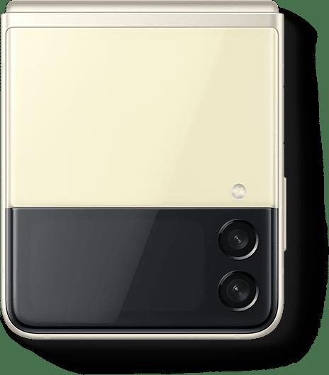 Un Galaxy Z Flip3 5G en color Cream plegado y visto desde la cubierta Front Cover.