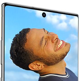 Galaxy Note10 plus seen from the front at a three-quarter angle from the power button side, showing the 10MP Selfie Camera. Onscreen is a photo shot on Galaxy Note10 and Note10 plus of man smiling with his head tilted backwards