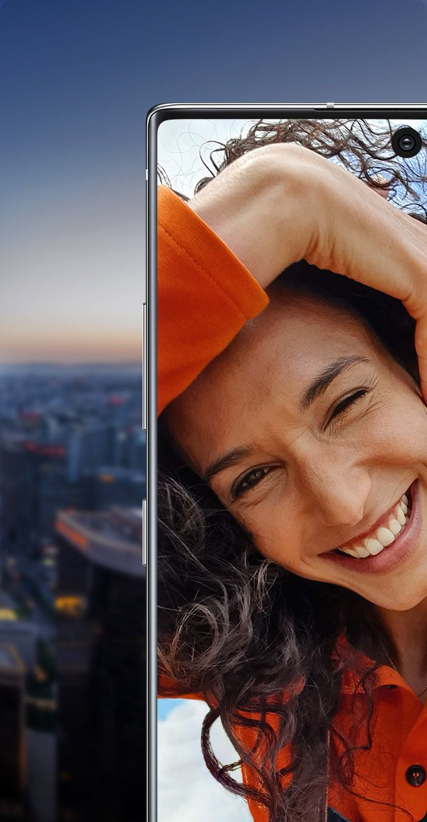 Galaxy Note10 plus split in half with a woman smiling onscreen. One half is shown against a night sky and the other half is shown against a daytime sky, demonstrating that the cinema-grade HDR10 plus display shows true colors, day or night