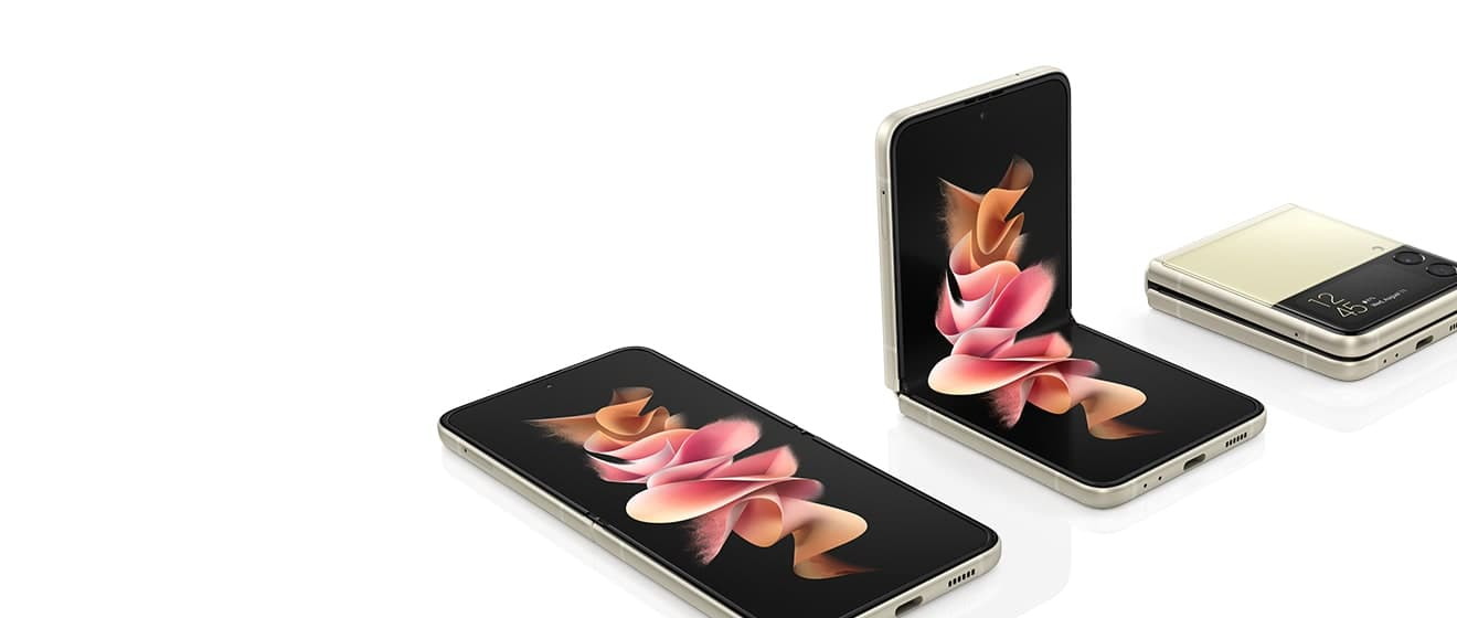 Three Galaxy Z Flip3 5G phones. One is unfolded and laying with a colorful wallpaper on the Main Screen. One is in Flex mode with a colorful wallpaper on the Main Screen. One is folded with the time displayed on the Cover Screen.