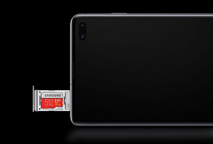 The upper half of Galaxy S10 plus in landscape mode seen from the front with the hybrid SIM tray ejected and one 512GB Samsung microSD card and one SIM card in place.