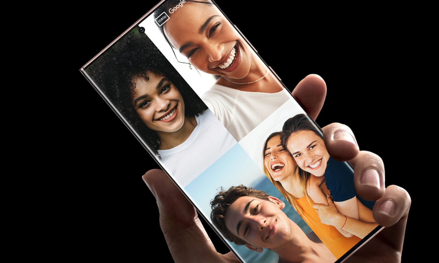 A hand holding Galaxy Note20 Ultra with a Google Duo video call with four callers and five people onscreen.