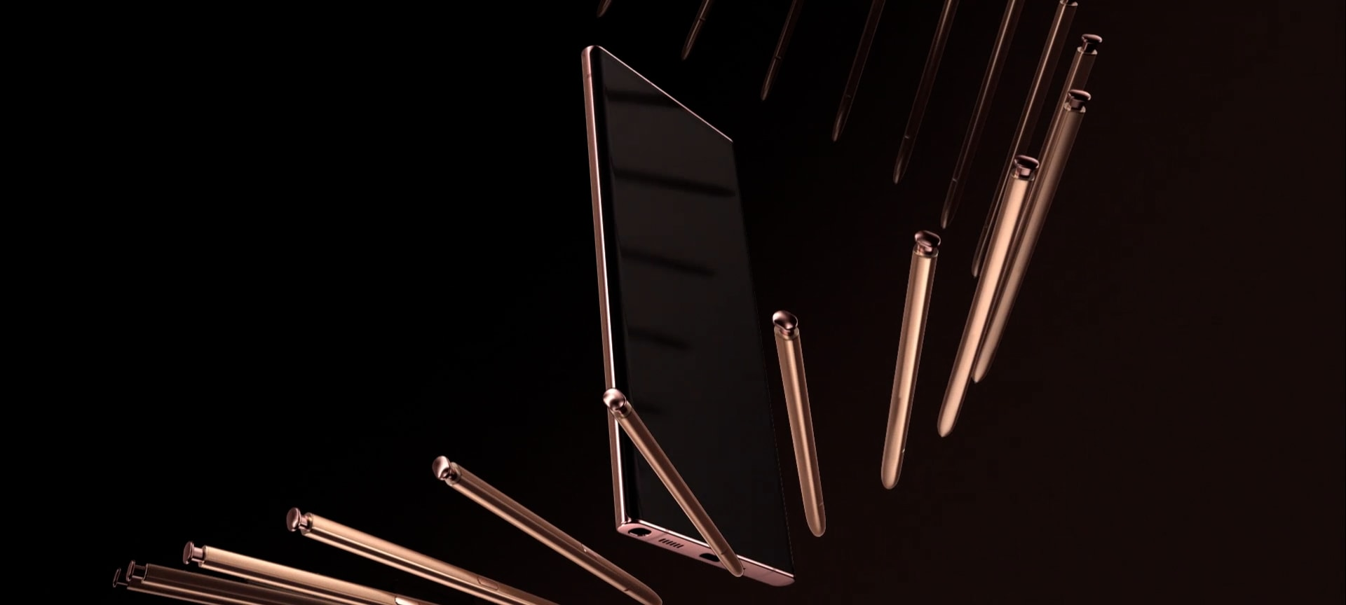 A close up of bronze S Pen drags across the screen of Galaxy Note20 Ultra, with a bronze trail following the pen tip. The display and pen turn until the phone is seen in full, with multiple S Pens moving around it.