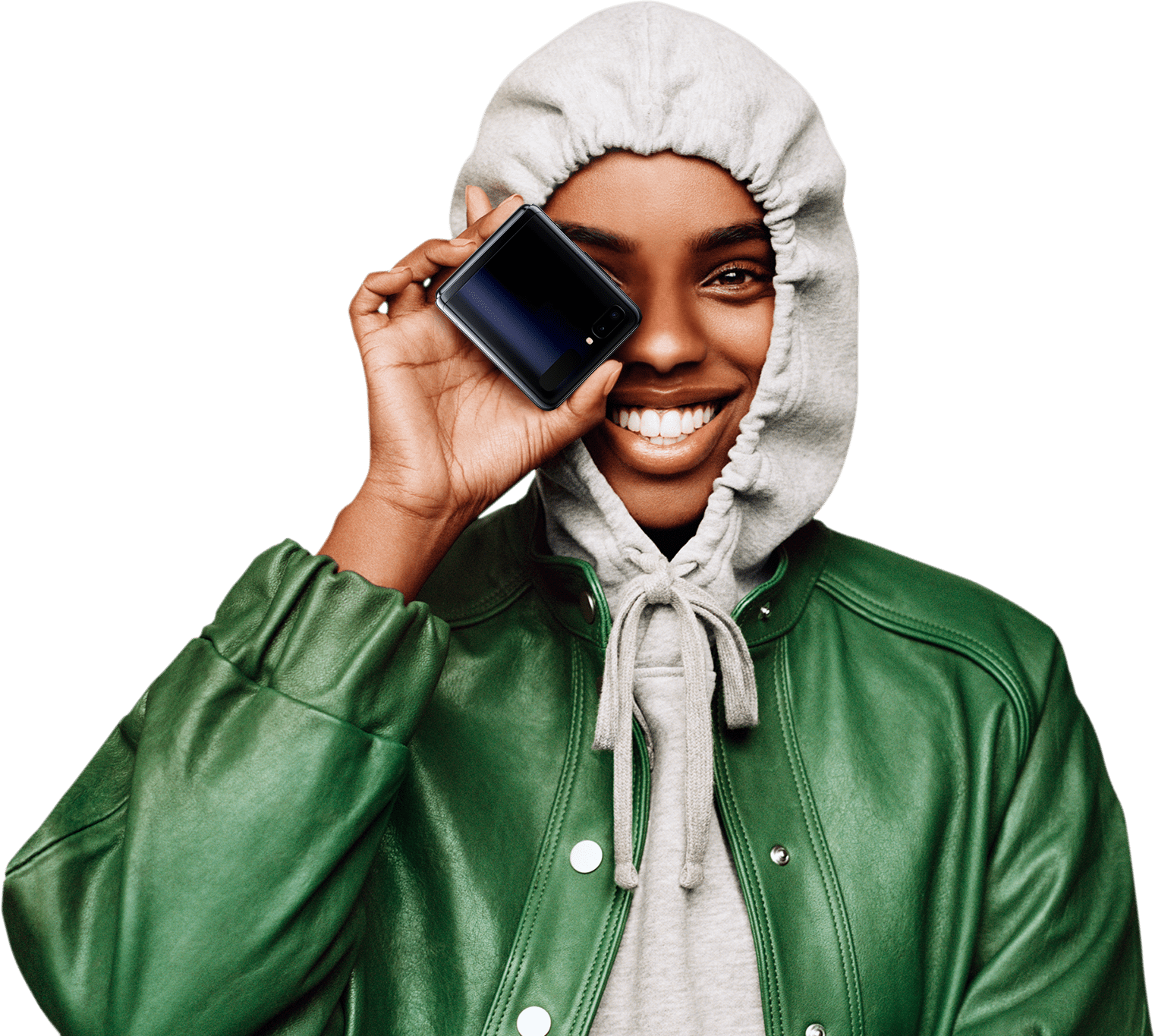 Mirror Black Galaxy Z Flip folded, spins as you scroll until it is facing with the rear camera and it turns into a photo of a woman holding it over her eye